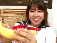 Asian teen with a banana