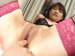 Megumi Morita Asian doll in stockings rides a hard cock