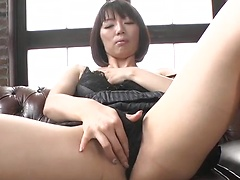 Naughty Asian slut Izumi Manaka caresses her pussy and sucks a cock
