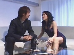Sexy Asian in black dress gobbles cock and gets pounded hard!