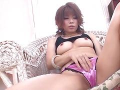 Busty asian beauty Juna Hara toys with a vibrator