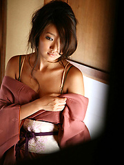 Sexy gravure idol beauty slowly takes off her pink kimono - Japarn porn pics at JapHole.com