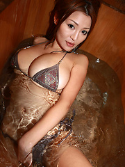 Sizzling asian hottie soaps up her giant plump tits in a bikini - Japarn porn pics at JapHole.com
