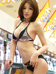 Stacked gravure idol babe plays the slots in her skimpy bikini - Japarn porn pics at JapHole.com