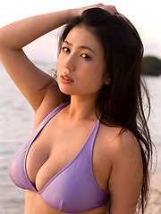 Lucious asian chick with massive tits in a tiny purple bikini - Japarn porn pics at JapHole.com