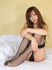 Gorgeous asian beauty in black lingerie and fish net stockings - Japarn porn pics at JapHole.com