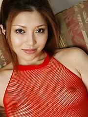 Sweet Japanese Aki Anzai in fishnet lingerie
