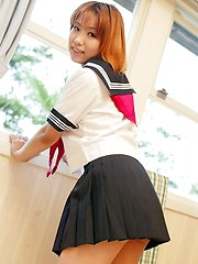 Naughty Yuri likes getting dressed in her sailor suit - Japarn porn pics at JapHole.com