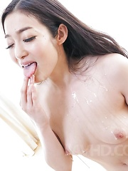 Ryu Enami licks cum she gets from sucked tools and shows pussy - Japarn porn pics at JapHole.com