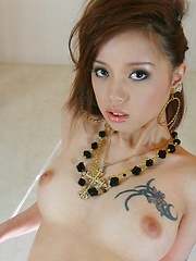 Lina Aishima strips off her black lingerie - Japarn porn pics at JapHole.com