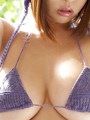 Very hot busty japanese Hitomi Kitamura posing in purple bikini - Japarn porn pics at JapHole.com