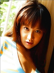 Ayami Sakurai posing big breasts in colored suite