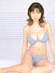 Rio Natsume posing in several bikinis her huge natural tits - Japarn porn pics at JapHole.com