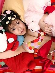 Hanai Miri posing her natural big tits in colored bikini - Japarn porn pics at JapHole.com