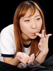 Redhead asian girl Yamamoto Misaki strokes black cock - Japarn porn pics at JapHole.com