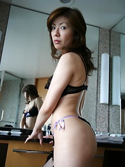In her black bra, panties and stockings, Miyuki Kobayashi is a sexy little Asian babe