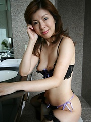 In her black bra, panties and stockings, Miyuki Kobayashi is a sexy little Asian babe - Japarn porn pics at JapHole.com