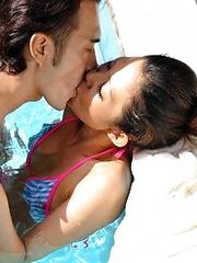 Japanese girl Yui Komine sucking a cock - Japarn porn pics at JapHole.com