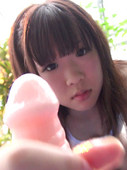 Petite Uri plays with a toy and imagines being in a jungle. That's this video concept she made up. Do you think it's Uri's first time licking a toy? - Japarn porn pics at JapHole.com