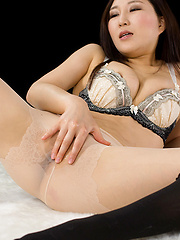 Kazuki Yuu posing in different stockings - Japarn porn pics at JapHole.com