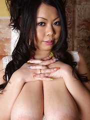 Big breasted japanese with colored big nails posing - Japarn porn pics at JapHole.com