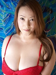 Busty Asian babe posing in red lingerie - Japarn porn pics at JapHole.com