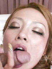 Rei Miyakawa Asian sucks strong penis and gets it from behind - Japarn porn pics at JapHole.com