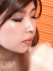 Ai Okada Asian rubs dicks with palms and soles in stockings