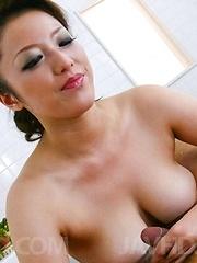 Meisa Hanai Asian rubs dude feet and dick between big hooters - Japarn porn pics at JapHole.com