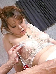 Asuka Asian has cans squeezed over fishnet and vibrator in peach - Japarn porn pics at JapHole.com