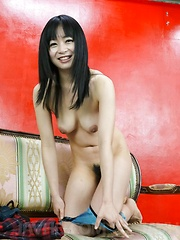 Nozomi Hazuki Asian sticks fingers in pussy while enjoys vibrator - Japarn porn pics at JapHole.com