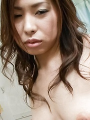 Chie Inamori Asian is undressed and has dark hairy pussy fingered - Japarn porn pics at JapHole.com