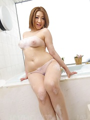 Alice Ozawa Asian busty puts vibrator on hairy cunt in fishnets - Japarn porn pics at JapHole.com