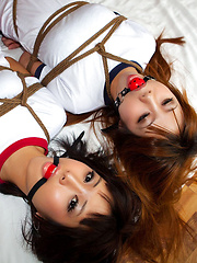 Dimdim Asian and nasty babe in t-shirts are tied in ropes on bed - Japarn porn pics at JapHole.com