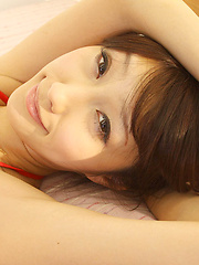 Satoko Asian takes dress off and rubs pussy in panty of her bed