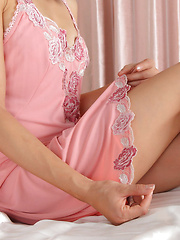 Rina Itoh Asian shows sexy legs under pink lingerie before sleep - Japarn porn pics at JapHole.com