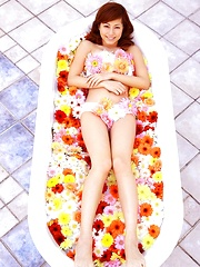 Yumi Sugimoto Asian is sexy baby surrounded by colorful flowers
