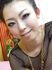 Yuki Asami Asian in fishnet strokes and rubs joystick with feet - Japarn porn pics at JapHole.com
