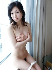 Nana Kurosaki Asian plays with her hot cans and gets fingered - Japarn porn pics at JapHole.com