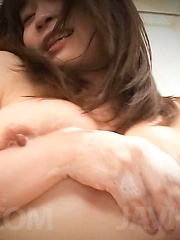 Nozomi Hatsuki Asian puts soap foam on her big jugs and on peach - Japarn porn pics at JapHole.com