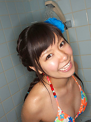Sweet Ayana Tanigaki smiles and poses at the kitchen with banana - Japarn porn pics at JapHole.com
