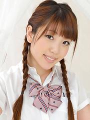Mizuho Shiraishi Asian with pigtails and uniform sits with ass up - Japarn porn pics at JapHole.com