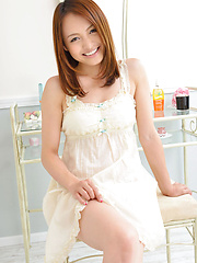 Rina Itoh Asian smiles and shows sexy legs under cute dress - Japarn porn pics at JapHole.com