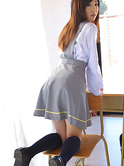 Mio Ayame Asian smiles and shows ass in panty under uniform - Japarn porn pics at JapHole.com