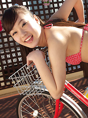 Kana Yuuki Asian in tiny bath suit is playful in and out of house - Japarn porn pics at JapHole.com