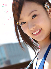 Kana Yuuki Asian in bath suit plays with umbrella in the balcony - Japarn porn pics at JapHole.com