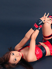Momoka Narushima Asian in red and black latex poses on the floor - Japarn porn pics at JapHole.com