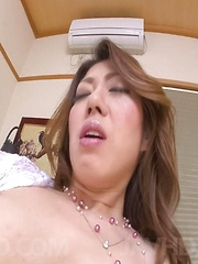 Reina Nishio Asian teases hard nipples and cooter with vibrator - Japarn porn pics at JapHole.com