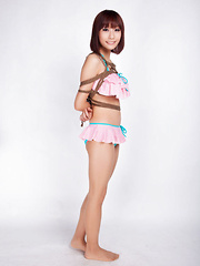 Ayaka Asian babe in tiny lingerie smiles while is tied in ropes - Japarn porn pics at JapHole.com