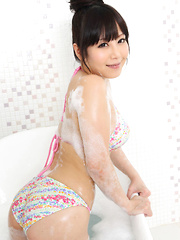 Maria Akamine Asian washes and soaps her body over bath suit - Japarn porn pics at JapHole.com